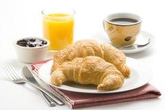 Prima colazione continentale di caffè e dei croissants fotografia stock