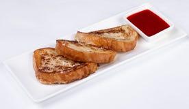 Prima colazione continentale - pane tostato, inceppamento Fotografia Stock
