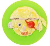 Prima colazione creativa dell'uovo per la forma del fronte del bambino Immagini Stock