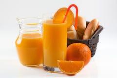 Prima colazione elegante del succo di arancia Fotografia Stock