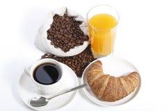 Prima colazione francese dalla tazza di caffè con il succo di arancia Fotografia Stock