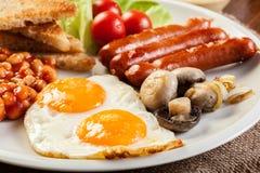 Prima colazione inglese con la salsiccia Immagini Stock Libere da Diritti