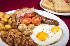 Prima colazione inglese cucinata Immagini Stock