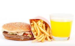 Prima colazione messa: succo di arancia, hamburger e patate fritte isolati su fondo bianco. Immagini Stock