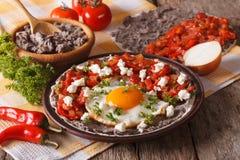 Prima colazione messicana: primo piano di rancheros di huevos orizzontale Fotografia Stock