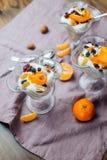 Prima colazione sana con le arance, i dadi ed il gelato Fotografia Stock Libera da Diritti