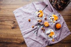 Prima colazione sana con le arance, i dadi ed il gelato Fotografia Stock