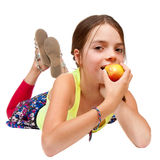 Primary Age Girl Eating an Apple Stock Photos