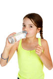 Primary Aged Girl Drinking Mineral Water Royalty Free Stock Photo