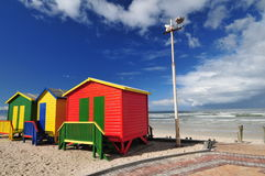 Primary Beach Huts. Three primary coloured beach huts on Muizenberg Coastline near Cape Town Stock Images