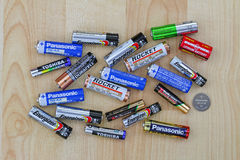 Primary cell and rechargeable battery from different brands on a Stock Image