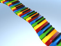 Primary color piano keyboard. Colorful piano keyboard with red, yellow, green and blue keys floating in the sky Royalty Free Stock Image