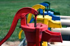 Primary color water pumps Stock Image