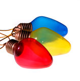 Primary Colored Bulbs. Row of primary colored light bulbs royalty free stock photography