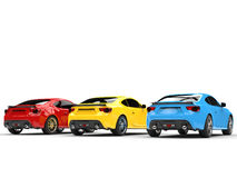 Primary colored generic sports cars - back view Royalty Free Stock Image
