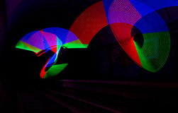 Primary colored LED lights lighting up a dark tunnel Stock Image