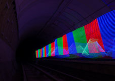 Primary colored LED lights lighting up a dark tunnel Royalty Free Stock Photo