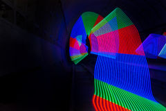 Primary colored LED lights lighting up a dark tunnel Stock Photography