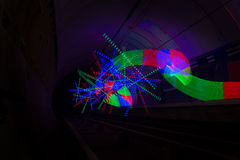 Primary colored LED lights lighting up a dark tunnel Stock Photos