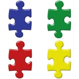 Primary Colored Puzzle Pieces. Set of 4 3D Puzzle Pieces in Primary colors isolated on white symbolizing Autism Awareness or, in a Business environment, the Stock Images