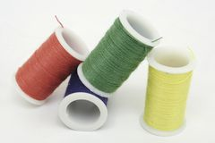 Primary Colored Thread. Spools of thread in primary colors standing, leaning, and laying Royalty Free Stock Photo