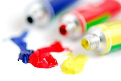 Primary colors paint. Macro of paint tubes of primary colors stock photo