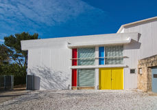 Primary colors red, blue and yellow. CALA MAYOR, MAJORCA, SPAIN - DECEMBER 19, 2015: Miro museum white building exterior with details in primary colors red, blue stock photography