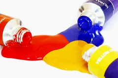 Primary Colours. Red yellow and blue acrylic paints pouring from a tube. Colour can be easily changed to any colour using hue/saturation in photo package Stock Photos