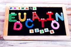 PRIMARY EDUCATION WRITTEN ON CHALK BOARDWITH ONE TWO THREE SIGN royalty free stock photo