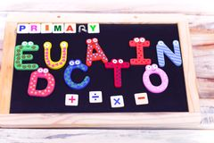 PRIMARY EDUCATION WRITTEN ON CHALK BOARDWITH PLUS MINUS SIGNS royalty free stock photos