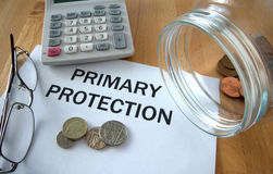 Primary protection. With coins on paper and in pot and calculator behind Royalty Free Stock Images