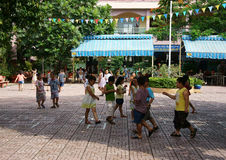 Primary pupil playing at grade school Stock Photo