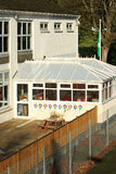 Primary school. A view of a British primary school showing a conservatory and playground Royalty Free Stock Photography