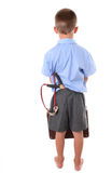 Primary school boy. Kid in primary school with naughty look and slingshot in back pocket Royalty Free Stock Photos