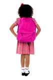 Primary school girl facing wall Royalty Free Stock Photo