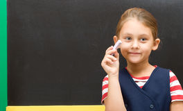 Primary school pupil with chalk Stock Photography