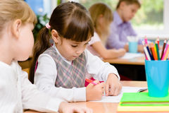 Primary school pupils write in their notebooks Royalty Free Stock Photo