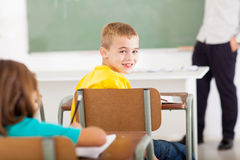 Primary school student. Cute primary school student looking back in classroom stock photography