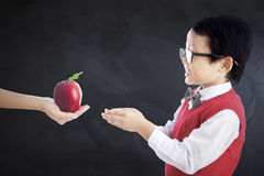 Primary school student gets apple fruit royalty free stock photos
