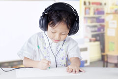 Primary school student studying in class with headset Royalty Free Stock Images