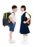 Primary school students. Asian primary school students in uniform and carried schoolbag Royalty Free Stock Images