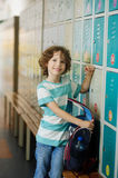 Primary school students standing in the hall near the lockers. Royalty Free Stock Image