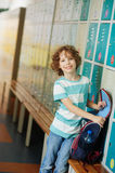 Primary school students standing in the hall near the lockers. Royalty Free Stock Photos