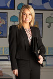 Primary School Teacher Standing In Classroom Royalty Free Stock Images