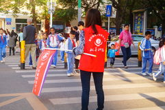 Primary school traffic intersection, parents volunteer to help maintain traffic safety order. In Shenzhen, china royalty free stock photos