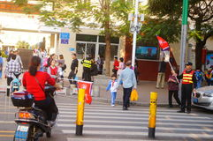 Primary school traffic intersection, parents volunteer to help maintain traffic safety order Stock Photo