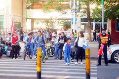Primary school traffic intersection, parents volunteer to help maintain traffic safety order Royalty Free Stock Photo