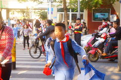 Primary school traffic intersection, parents volunteer to help maintain traffic safety order Royalty Free Stock Image