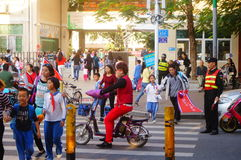 Primary school traffic intersection, parents volunteer to help maintain traffic safety order Stock Photos