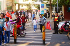 Primary school traffic intersection, parents volunteer to help maintain traffic safety order Royalty Free Stock Photos
